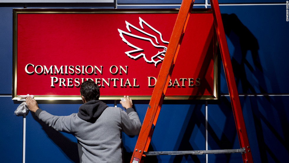 A worker cleans a sign for the Commission on Presidential Debates before the second presidential debate in Hempstead, New York, on Tuesday.