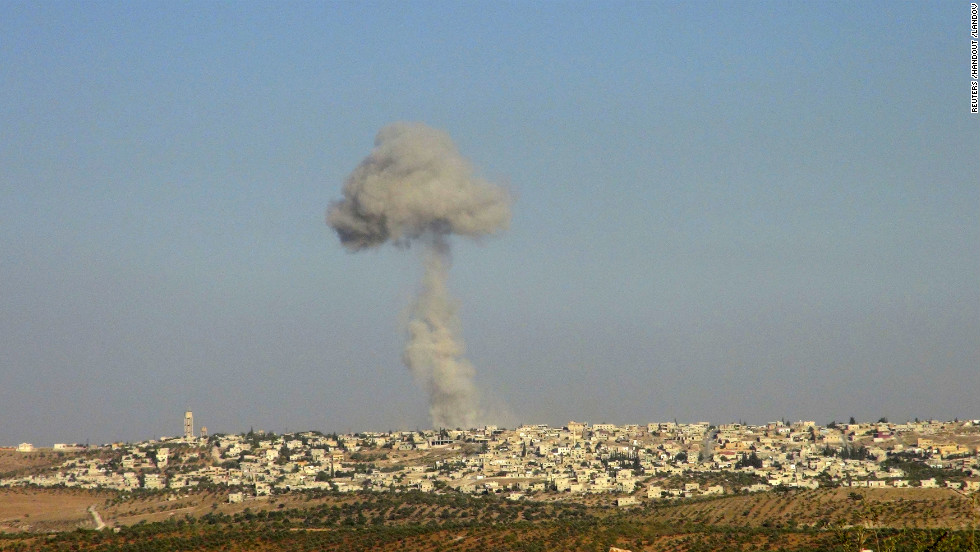 Smoke rises after a Syrian Air Force fighter jet fired missiles at the suburbs of the northern province of Idlib on October 16, 2012.