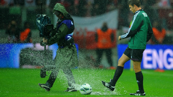 Match referee Gianluca Rocchi inspects the pitch prior to canceling Tuesday