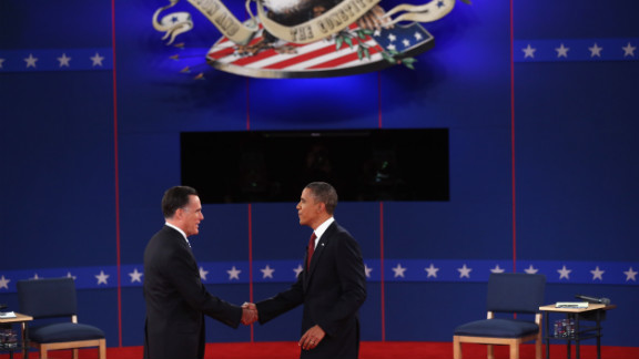 Republican presidential candidate Mitt Romney and U.S. President Barack Obama greet each other on stage.