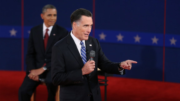Republican presidential candidate Mitt Romney addresses a question as President Obama listens.