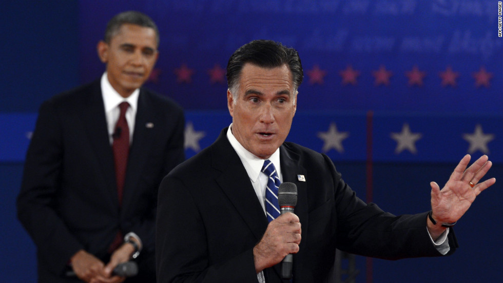 U.S. President Barack Obama listens to Republican presidential candidate Mitt Romney.