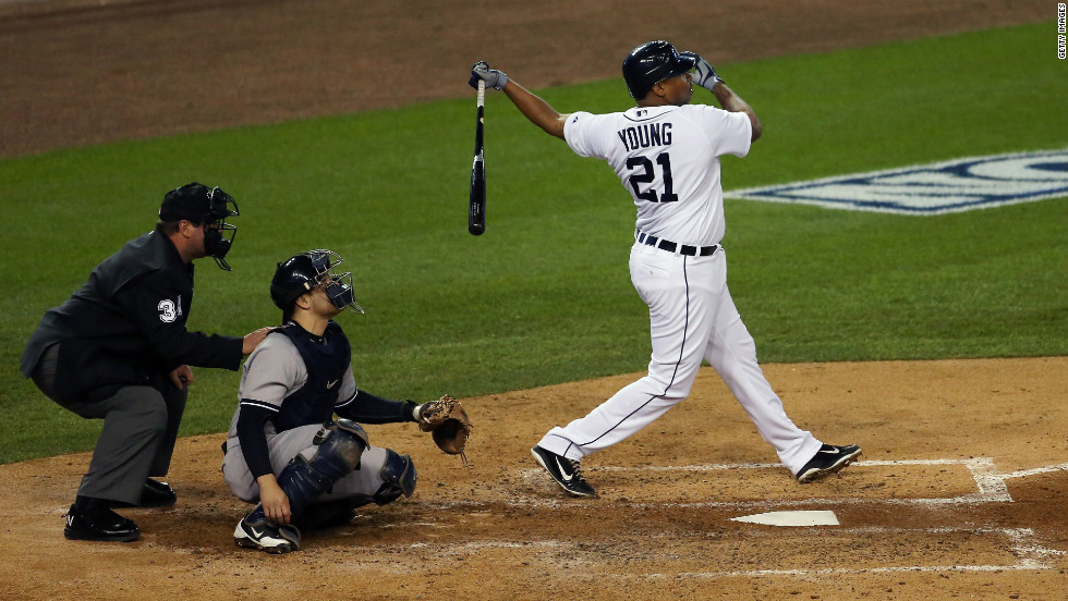 Delmon Young of the Detroit Tigers watches his hit sail into the outfield as a home run during Game 3.