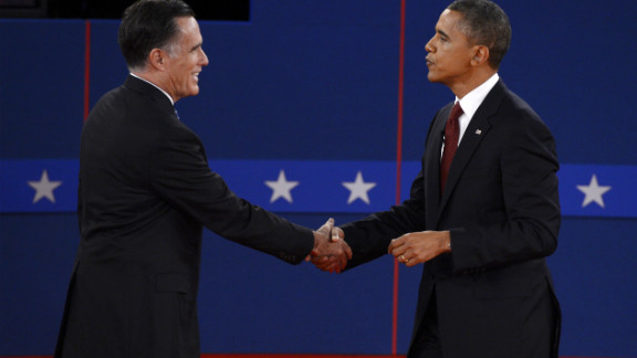 Mitt Romney, left, and President Obama shake hands following Tuesday