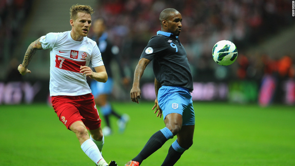 England's Jermain Defoe shields the ball from Poland's Eugen Polanski during the World Cup qualifier in Warsaw. The Tottenham striker had a glorious opportunity to extend England's lead in the second-half but failed to hit the target from close-range.