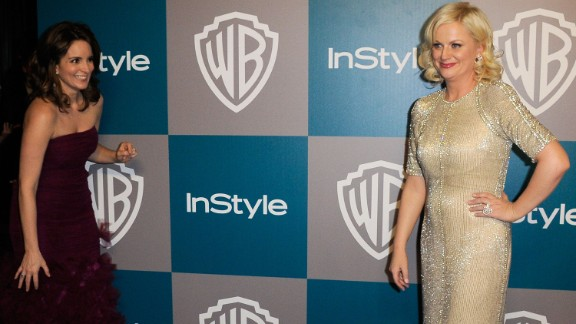 Fey sneaks up on Poehler at InStyle