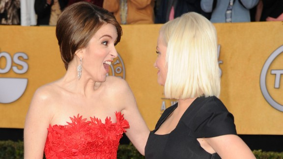 Fey and Poehler greet each other on the red carpet at the 2011 Screen Actors Guild Awards.