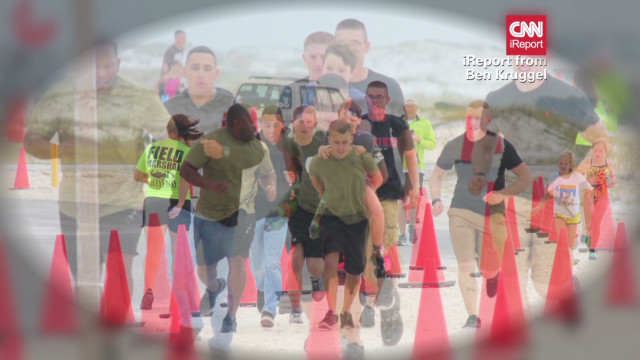Marine carries boy to triathlon finish