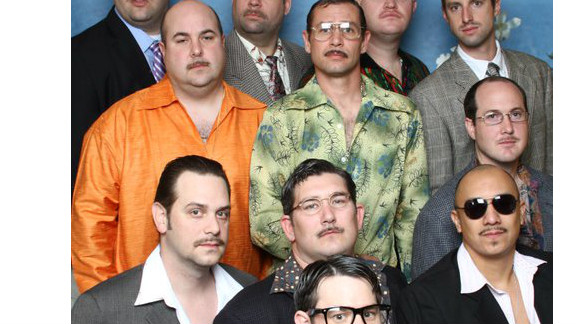 """These college buddies have gathered annually for """"Man Weekend"""" since 2008. On Saturday mornings they dress to a theme that includes facial hair."""