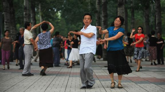 Beijing residents practice ballroom dancing in a park on July 31, 2008 in Beijing, China.