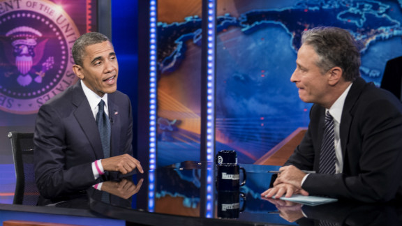 Barack Obama and Jon Stewart speak during a break in the live taping of Comedy Central