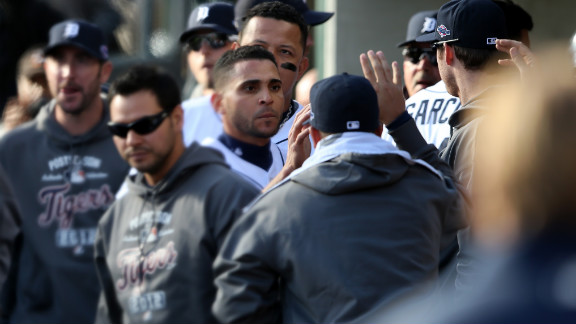 Infante celebrates in the dugout with teammates after scoring in the first inning.