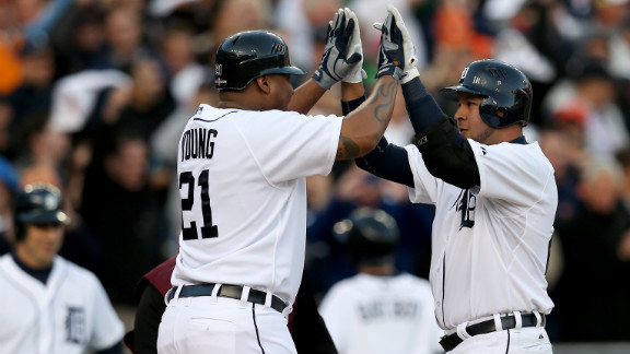 Delmon Young, left, and Jhonny Peralta of the Detroit Tigers celebrate after scoring on Peralta