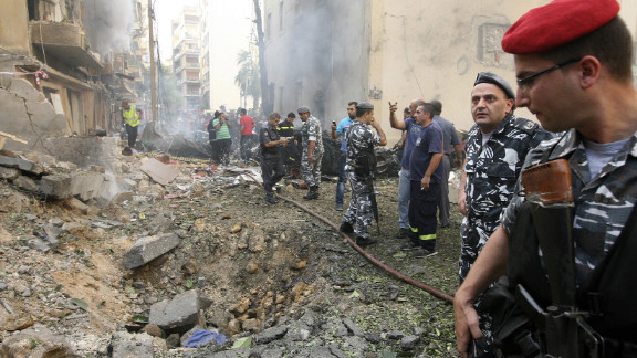Lebanese police stand by a crater as they secure the site.