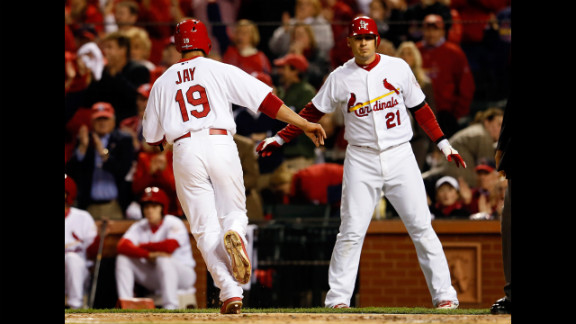 JJon Jay  and  Allen Craig of the St. Louis Cardinals celebrate after Jay scores on a single by Matt Holliday in the first inning against the San Francisco Giants in Game 4 of the National League Championship Series at Busch Stadium on October 18, in St Louis, Missouri. Look back at Game 2 of the NLCS.