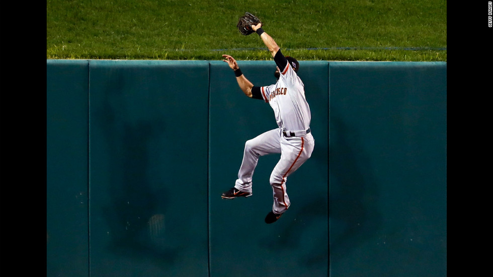 Angel Pagan of the San Francisco Giants makes a catch at the wall on a ball hit by Yadier Molina of the St. Louis Cardinals.