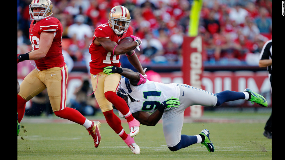 Wide receiver Kyle Williams of the San Francisco 49ers breaks away from defensive end Chris Clemons of the Seattle Seahawks.