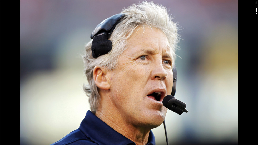 Head coach Pete Carroll of the Seattle Seahawks makes a call from the sidelines against the San Francisco 49ers in the first quarter.