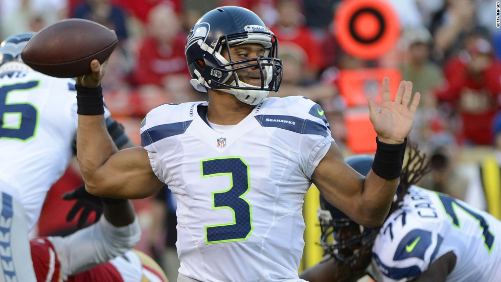 Russell Wilson of the Seattle Seahawks drops back to pass against the San Francisco 49ers.