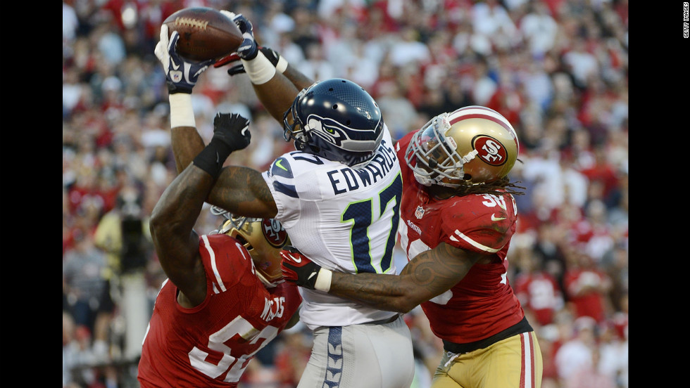 Braylon Edwards of the Seattle Seahawks has this pass broken up in the end zone by Patrick Willis and Dashon Goldson of the San Francisco 49ers.