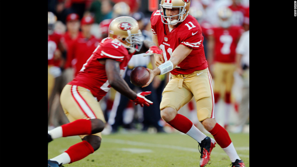 Quarterback Alex Smith hands off to running back Frank Gore during Thursday's game against the Seattle Seahawks.
