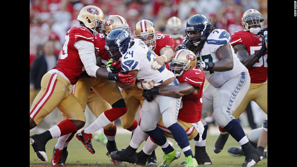 "Marshawn Lynch of the Seattle Seahawks is overcome by the San Francisco 49ers defense as he runs the ball. <a href=""http://www.cnn.com/2012/10/11/worldsport/gallery/nfl-week-6/index.html""><strong>Look back at the best from Week Six of the NFL.</a></strong>"