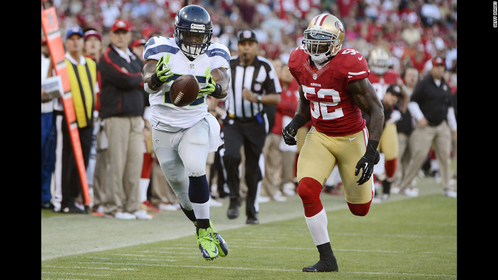 Runningback Robert Turbin, left, of the Seattle Seahawks beats Patrick Willis of the San Francisco 49ers.