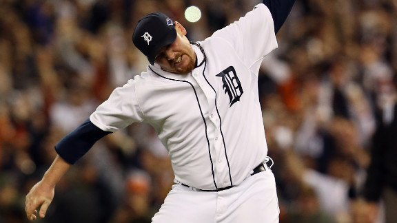 Tigers pitcher Phil Coke celebrates after the final out of Game 4 as the Tigers clinch the American League Championship and move on to the World Series.