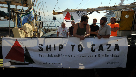 Crew members of the Estelle get ready to leave for Gaza at the port of Naples.
