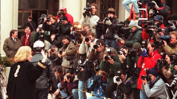 Clinton waves to the media in January 1996 as she arrives for an appearance before a grand jury in Washington. The first lady was subpoenaed to testify as a witness in the investigation of the Whitewater land deal in Arkansas. The Clintons
