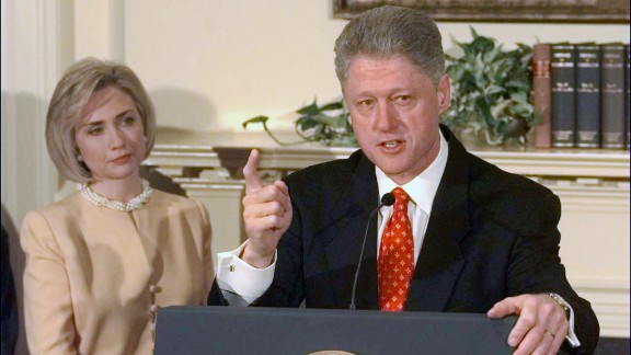 "Clinton looks on as her husband discusses the Monica Lewinsky scandal in the Roosevelt Room of the White House on January 26, 1998. Clinton declared, ""I did not have sexual relations with that woman."" In August of that year, Clinton testified before a grand jury and admitted to having ""inappropriate intimate contact"" with Lewinsky, but he said it did not constitute sexual relations because they had not had intercourse. He was impeached in December on charges of perjury and obstruction of justice."