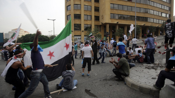 Protesters hurled sticks, stones and flags on Sunday. A number of injuries were reported, Lebanon