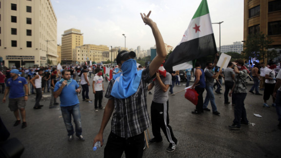 Anti-government protesters demonstrate outside the government palace on Sunday.