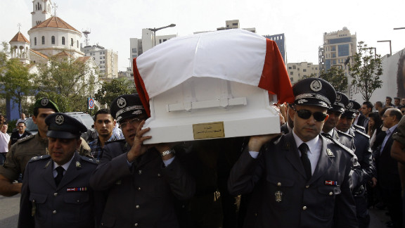 Lebanese officers of the Internal Security Forces carry the intelligence chief's coffin on Sunday.