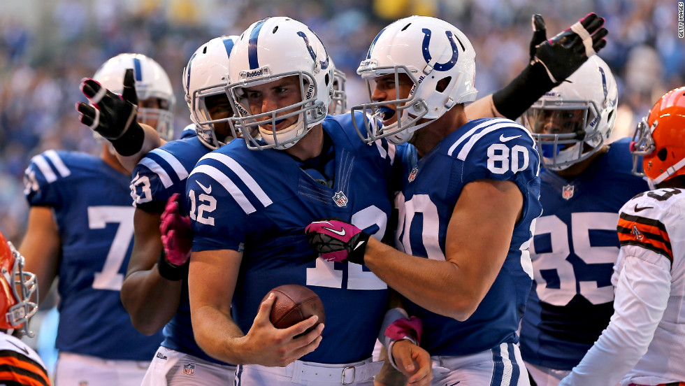 No. 12 quarterback Andrew Luck of the Indianapolis Colts is congratulated by No. 80 Coby Fleener and No. 83 Dwayne Allen after running for a touchdown against the Cleveland Browns.