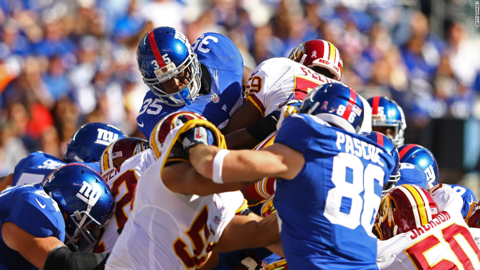 No. 35 Andre Brown of the New York Giants scores a touchdown against the Washington Redskins during their game on Sunday at MetLife Stadium in East Rutherford, New Jersey.