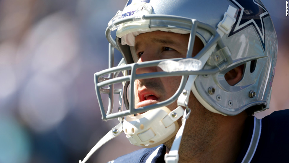 Quarterback Tony Romo of the Dallas Cowboys watches the action during their game against the Carolina Panthers.