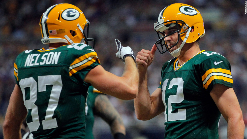 No. 87 Jordy Nelson and No. 12 Aaron Rodgers of the Green Bay Packers celebrate the team's three-yard touchdown reception against the St. Louis Rams in the first quarter.
