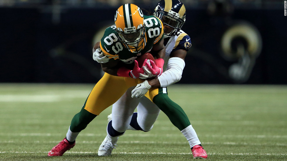 The Packers' James Jones makes a reception on Sunday against the Rams' Janoris Jenkins.