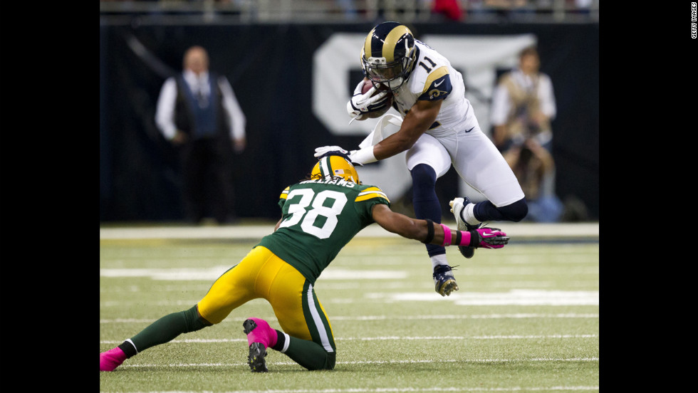 Wide receiver Brandon Gibson of the Rams leaps over cornerback Tramon Williams of the Green Bay Packers during Sunday's game.