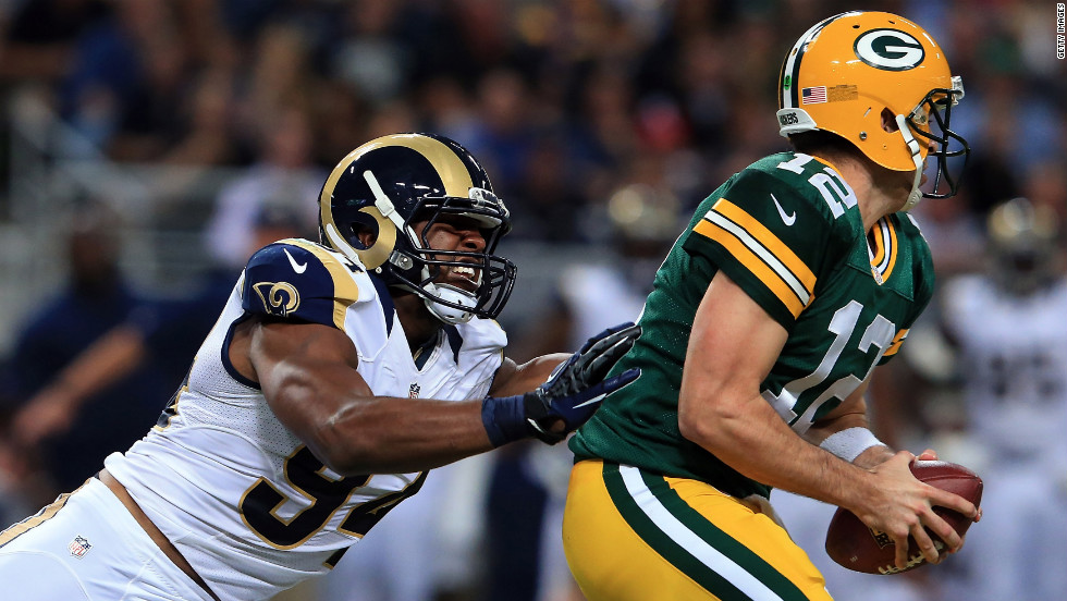 Defensive end Robert Quinn of the St. Louis Rams pursues quarterback Aaron Rodgers of the Green Bay Packers at Edward Jones Dome on Sunday.