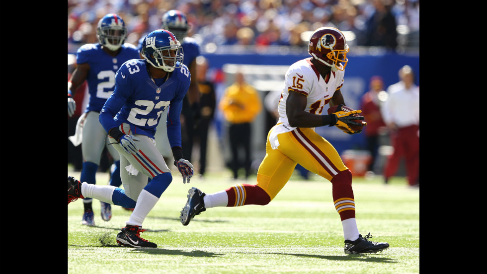 Corey Webster of the Giants chases Josh Morgan of the Redskins as he makes a catch on Sunday.