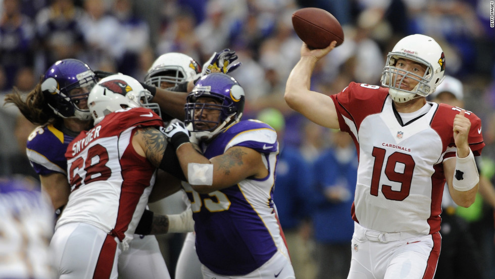 John Skelton of the Cardinals passes the ball during the first quarter against the Minnesota Vikings on Sunday.
