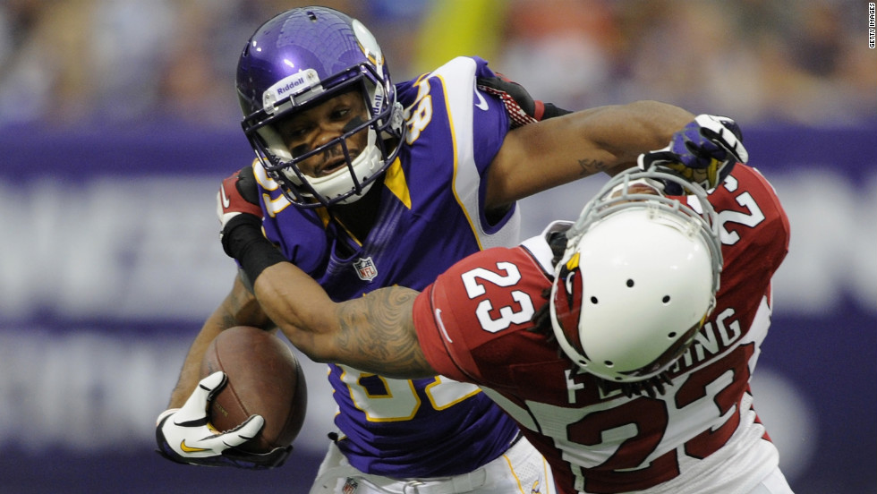 Jamell Fleming of the Arizona Cardinals tackles Jerome Simpson of the Minnesota Vikings during the first quarter on Sunday at Hubert H. Humphrey Metrodome in Minneapolis.