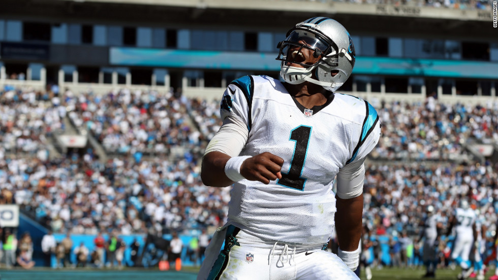 Cam Newton of the Panthers celebrates after his team scores a touchdown against the Dallas Cowboys.