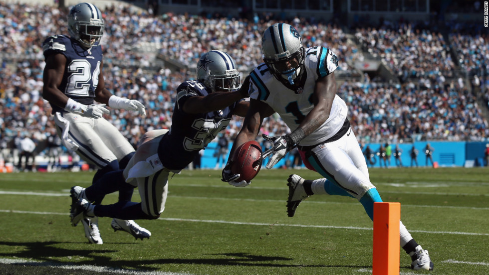 Carolina's Brandon LaFell dives for a touchdown against Brandon Carr of the Cowboys on Sunday.