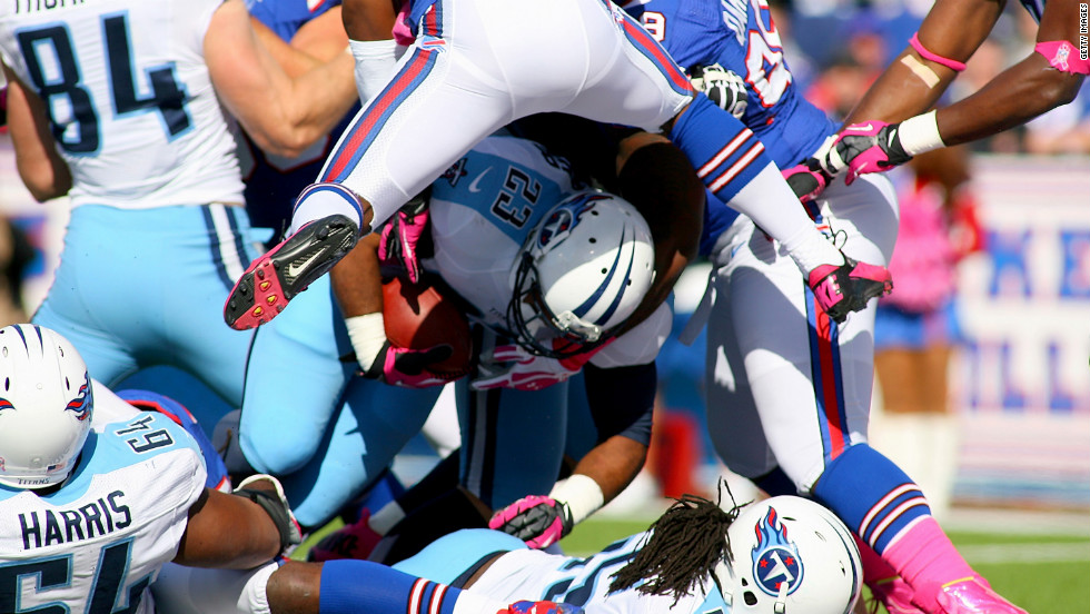 Jamie Harper of the Tennessee Titans dives over the goal line for a touchdown against the Buffalo Bills on Sunday.
