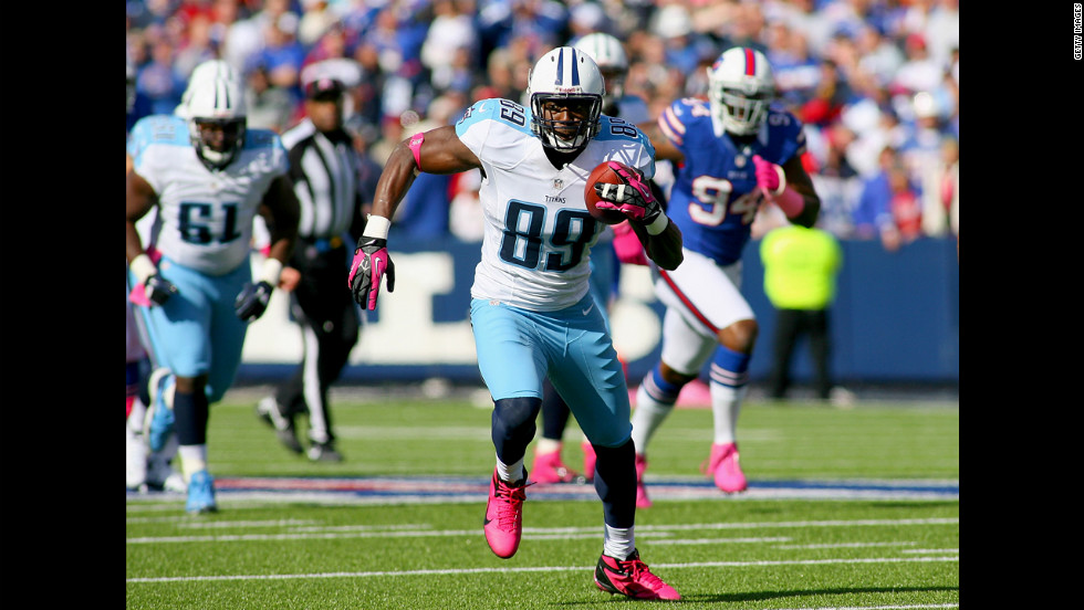 Jared Cook of the Titans runs after a pass reception against the Bills.