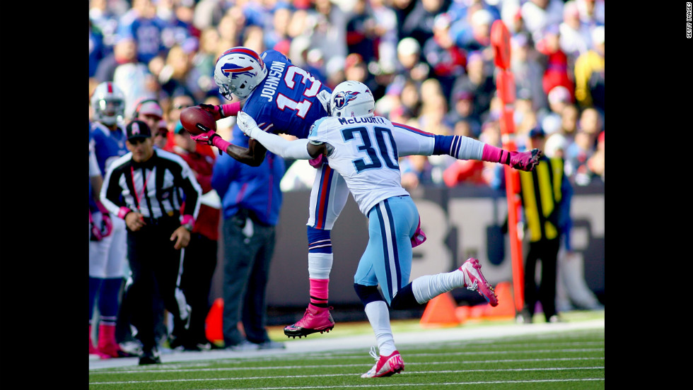 Steve Johnson of the Bills makes a catch against Jason McCourty of the Titans.