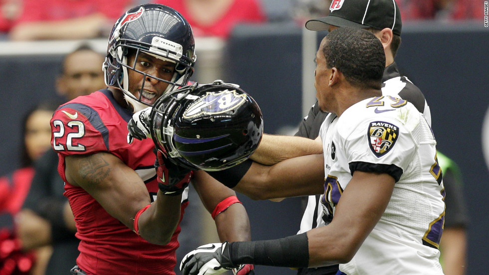 Alan Ball of the Houston Texans and Cary Williams of the Baltimore Ravens get tangled up in the second quarter on Sunday.